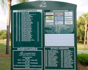 Sign on A9 green that includes platinum and gold sponsors.
