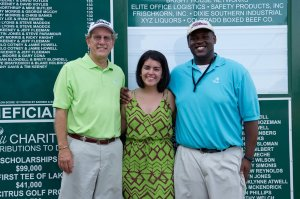 4-Ball President Joe Birkner, left, with 2012 scholarship winners Alyssa Martinez and Edward Williams.